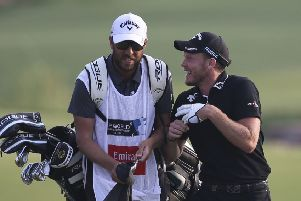 Danny Willett talks with his caddy as they approach the 18th green on Sunday at the DP World Tour Championship in Dubai. Picture: AP/Kamran Jebreili
