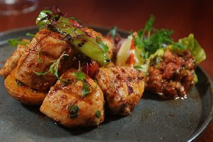 Chicken marinated and cooked the traditional way by being'chargrilled on a brochette. Served with saut�d potato, rice and chilli relish. PIC: Tony Johnson