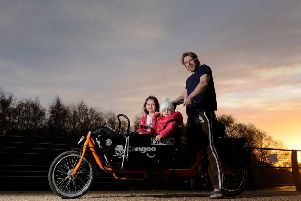Stephen Broughton-Roe pictured with his children, Islie aged 7, Edie age 2 and Remy (hidden) aged 9 months with his Dutch Cargo Bike by the River Aire Leeds..30th November 2018..Picture by Simon Hulme