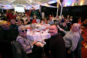 Mike Day is pictured with guests at the Christmas lunch. Picture by Simon Hulme