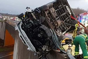 Mr Dulson's van overturned Iveco van hanging on a bridge at junction 44 near Bramham, above the A64 motorway.