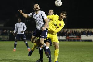Guiseley's Alex Purver and Fleetwood Town's Ched Evans battle for the ball.
