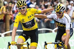 Geraint Thomas celebrates  with team mate Chris Froome on the Tour de France.