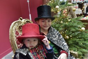 Leeds Playhouse and Leeds Corn Exchange joined  forces to host a free family'friendly takeover day on Saturday. Sammy, three and Oliver, 10 Barker of Armley dressing up.