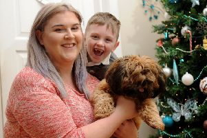 Riley Hoult pictured with mum Sophie Hoult and the family dog Coco at their home at Middleton.''Picture by Simon Hulme