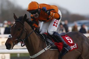 Winners: Tom Scudamore rides Thistlecrack to King George success in 2016.