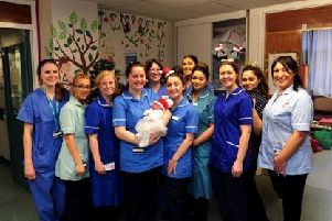 Ada May Ainsley-Moss, pictured with staff at St James's Hospital, Leeds following her birth in the early hours of Christmas Day. Picture by Simon Hulme.