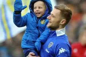 Toby Nye with Leeds United captain Liam Cooper.