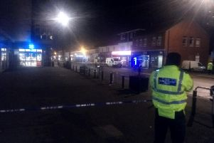 Police at the scene of the collision on Main Street, Garforth.