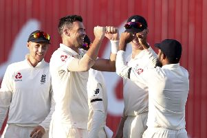 England's James Anderson celebrates with team-mates.