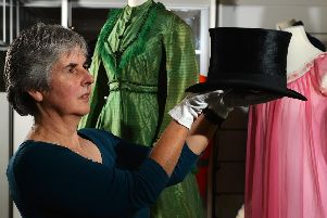 Danger Zone, a new exhibition which opens at Kirkstalls Abbey House Museum later this week, explores some of the surprising everyday threats that were hiding in plain sight in homes and workplaces over the past 150 years. 'Social History Curator Kitty Ross with a dapper-looking top hat containing mercury, a common material used when the headgear was made in around 1840.