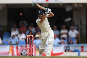 TOP MAN: England's Jonny Bairstow drives one through the covers in his innings of 52 on the first day of the second Test in Antigua. Picture: Shaun Botterill/Getty Images.