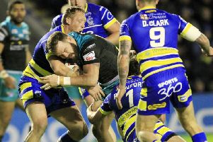 Warrington's Ben Westwood (far left) tackles Leeds Rhinos' Adam Cuthbertson on Saturday night (SWPix)