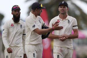 It's all gone wrong: England's captain Joe Root, centre, James Anderson, right, and Moeen Ali leave the field after losing by 10 wickets against the West Indies.