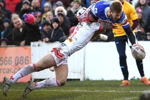 Wakefield's Tom Johnstone beats Saints Theo Fages to claim his spectacular first try. PIC: Jonathan Gawthorpe