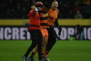 Injured Mitch Clark is taken off the pitch at Hull. Picture: Matthew Merrick