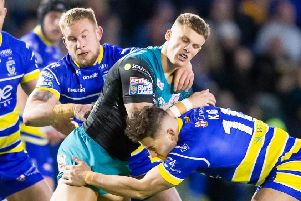 Liam Sutcliffe is tackled by Warrington's Mike Cooper and Toby King.