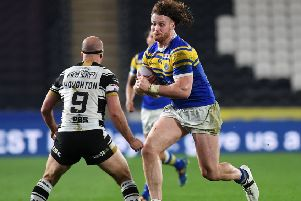 Rhinos.'Rhinos Anthony Mullally takes on Hull's Danny Houghton. 'Picture Jonathan Gawthorpe