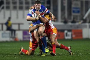 Wakefield's James Batchelor is halted by Catalans defence. (Picture: Jonathan Gawthorpe)