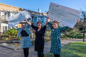 Kate Bratt-Farrar, hospice director for Sue Ryder Wheatfield Hospice, and Kerry Jackson, chief executive at St Gemma's Hospice  receeived the latest cheque from the Yorkshire Evening Post Editor Hannah Thaxter in January. 'Picture: James Hardisty
