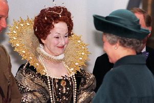 Una Stubbs, in a costume of Queen Elizabeth 1, meets Queen Elizabeth 2 during her visit to Leeds for the opening of The Royal Armouries on the 15th March 1996.