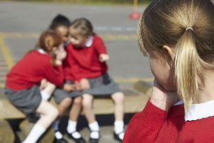 A Generic Photo of elementary school girls whispering in playground about another pupil. See PA Feature FAMILY Lonely. Picture credit should read: PA Photo/thinkstockphotos. WARNING: This picture must only be used to accompany PA Feature FAMILY Lonely.