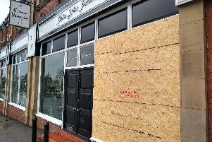 The front of the store in Leeds is now boarded up after a ram-raid on Wednesday night.