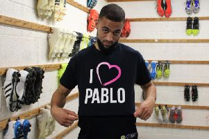 Kemar Roofe tries on the range's Pablo Hernandez T-shirt - complete with a tongue-in-cheek look of disdain.