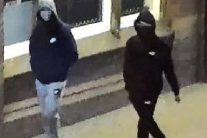 The face of the suspect shown on the left has been obscured due to the arrest in connection with this incident.