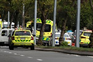 Ambulances parked outside a mosque in central Christchurch, New Zealand, Friday, March 15, 2019. Many people were killed in a mass shooting at a mosque in the New Zealand city of Christchurch on Friday, a witness said. Police have not yet described the scale of the shooting but urged people in central Christchurch to stay indoors. (AP Photo/Mark Baker)