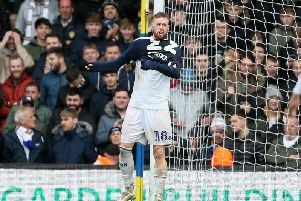 UNLIKELY SIGHT: Leeds United centre-back Pontus Jansson pulls on Kiko Casilla's goalkeeping jersey to take his place in net after the Spaniard's sending off.