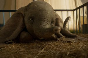 EARS TO YOU ' In Disney's all-new, live-action feature film 'Dumbo,' a newborn elephant with oversized ears make him a laughingstock in an already struggling circus. But Dumbo takes everyone by surprise when they discover he can fly. Directed by Tim Burton, 'Dumbo' flies into theaters on March 29, 2019. �2018 Disney Enterprises, Inc. All Rights Reserved.