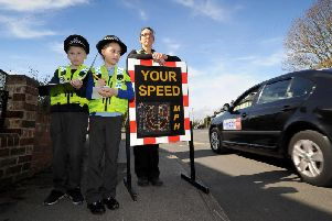 Children from Hawsworth Wood Primary School Hawksworth, Leeds, take part in a day of action with local Police..Connor Lake aged 9 and Bernice Bladon are pictured with PC Helen Brayshaw speed checking vehicles on the Hawksworth Estate..20th March 2019.Picture by Simon Hulme