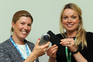 Dr Sarah Forbes and Macmillan's Helen Ryan with the equipment.