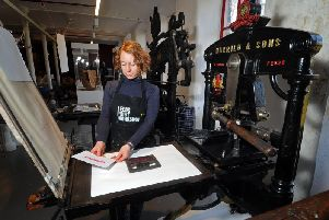 Founding member of Leeds Print Workshop Kirstie Williams using the museums 169-year-old Albion Press,  back up and running for a special demonstration of traditional letterpress printing. Picture: Tony Johnson.