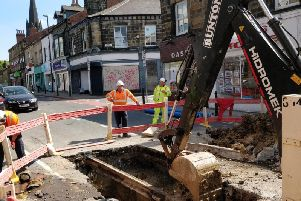 Yorkshire Water engineers work on a burst main on Otley Road last summer (pic: Robyn Vinter)