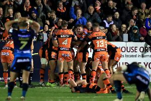 Castleford Tigers celebrate after Peter Mata'utia scores his side's final try with the last touch of the game.