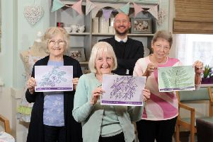 David Wood, Anchors community partnership manager with  Val Ashford, Ann Paul and Maureen Jones, residents at Halcyon Court care home in in Cliff Road, Headingley.'Pensioners living at Halcyon Court -  along with residents at Beech Hall in Armley, and Oak Tree Lodge in Gipton - have designed postcards that will be placed in community hubs across the city.' The aim is for people to send the postcards back to the residents so they can start writing to each other. 'Picture: Tony Johnson