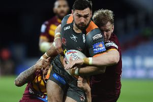 Castleford's Matt Cook is tackled by Huddersfield's Alex Mellor and Aaron Murphy.' Picture: Jonathan Gawthorpe.