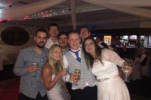 Poppy (front left) with friends at a wedding, in a photo posted by Team Poppy on their fundraising page