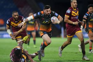 Matt Cook on the attack against Huddersfield. 'Picture: Jonathan Gawthorpe.