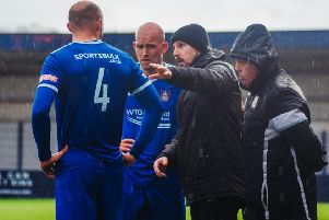 Farsley Celtic boss Adam Lakeland gives instructions to his players. Picture: John McEvoy.