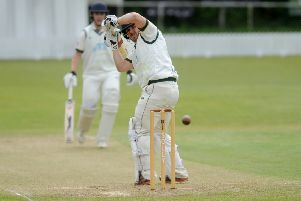 New Farnley's 'Steve Bullen watches the ball clear his stumps in a game against Woodlands that was eventually abandoned. PIC: Steve Riding
