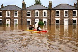 Ccanoeists taking advantage of the floods in Beverley, East Yorkshire. The 2007 floods brought devastation to Sheffield and Hull.