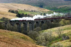 The Flying Scotsman crossing the Dent Head Viaduct on its  return journey from Carlisle to Oxenhope to celebrate the re-opening of the Settle Carlisle Railway line.  31 March 2017.