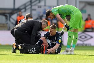 Leeds United's Adam Forshaw picks up an injury during the first half at Pride Park.
