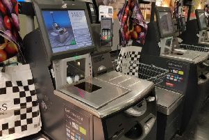 Supermarkets are being urged to introduce a 1p charge to use self-checkout machines