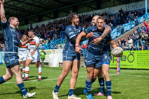 Dane Chisholm celebrates one of his three tries for Featherstone Rovers against Bradford Bulls. Picture: James Heaton