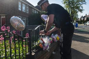 Police with flowers left in the street in Sheffield