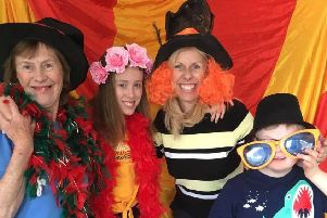 SMILE: A family in fancy dress at Leeds Weekend Care Association's 20th birthday party at the Vine Education Centre last Saturday.